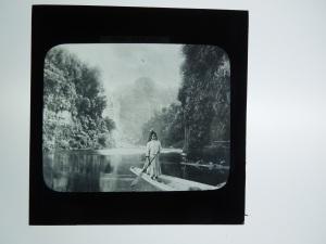 Maori Girl in Canoe